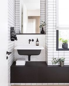 Loving this black and white small space bathroom @falkenreynolds designed for a west side family here in Vancouver. Visit their feed for all of the sources. @emaphotographi