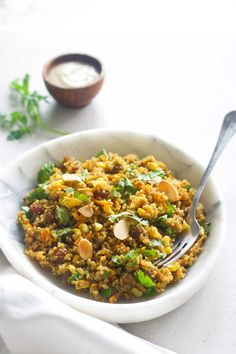 Warm Curried Quinoa Salad with Yoghurt Tahini Dressing. Filled with carrot, corn, sultanas, coriander and almonds. Vegan and Gluten-free.