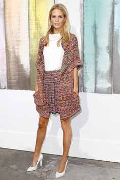 Poppy Delevingne in a Chanel outfit during the French brand's Spring/Summer 2014 show organised by Karl Lagerfeld on October 1