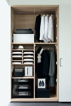 white cupboards (wardrobe) with pale wood interior fitting and smoked glass drawers - how lovely