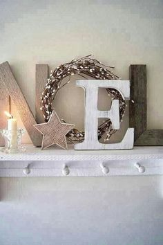Inexpensive Ways Of Decorating Your Home For The Holiday Season NOEL letters made from rustic wood plus a simple wreath. Love this presentation.NOEL letters made from rustic wood plus a simple wreath. Love this presentation. Noel Christmas, Merry Little Christmas, Christmas Is Coming, Winter Christmas, Christmas Letters, Christmas Scrapbook, Christmas Design, Christmas Lights, Christmas Mantal