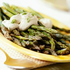 Asparagus cooks quickly and can be ready, with a creamy Dijon sauce, in 15 minutes. An easy way to remove scales from asparagus spears is with a vegetable peeler.