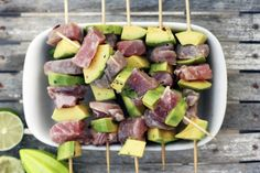 One thing no one ever thinks to put on a skewer and grill? Tuna and avocado. It's fresh, zesty with a marinade of lime and herbs and ridiculously healthy. Eat them immediately