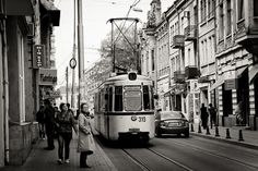 Photo about IASI, ROMANIA - APRIL Trams and people on the Cuza Voda street in downtown on April 2010 in Iasi, Romania. Image of historic, street, artistic - 15487126 Romania, Photos, Street View, Urban, Graphic Design, Black And White, People, Image, White Photography