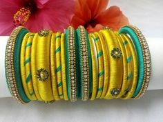 Ramar Green with Yellow Color Silk Thread Bangles with Grand Decoration Its purely handmade products. Whole sellers are also welcome. Its available in all sizes and Silk Thread Bangles Design, Silk Bangles, Silk Thread Earrings, Bridal Bangles, Thread Jewellery, Diy Jewellery, Jewellery Designs, Jewellery Making, Bangle Set