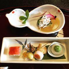 Top: fugu skin & sashimi in yuzu miso Bottom: smoked salmon sushi mukago potato shinjo Noshi-ume (plum jelly) ginnan shake kinuta maki (salmon rolled in daikon) tarako kimiage zunda mochi