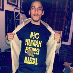 """""""No human being is illegal""""  [follow this link for a short clip and analysis of how the word """"illegal"""" is often used as a racially coded term directed at non-white immigrants: http://www.thesociologicalcinema.com/1/post/2010/12/drop-the-i-word.html]  Pictured: Jay Espy (http://revolutionary-afrolatino.tumblr.com/post/76145935374)"""