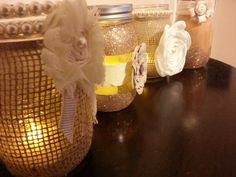 My friend and I made these! DIY mason jar candles or it can be used as a flower vase, or centerpieces for a wedding!