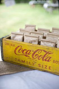 Love the Coca-Cola crate holding the favor bags