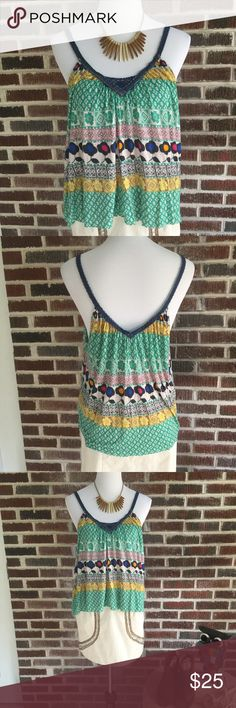 """Free People Tank Cute Free People Tank for Urban Outfitters.  Has v-neck front and back.  Cute and colorful.  Throw on a pair of jeans or shorts or a skirt and go.  Meant to fit flowy, pair with a bralette for added accessorizing and color.  Goes really with the Ark & Co Skirt also available in my closet.  Chest measures ~21"""" armpit to armpit and length measures ~22.25"""".  Has a raw edge hem. Free People Tops Tank Tops"""