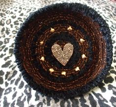"""""""ANGEL HEART"""" Coiled yarn basket with copper metal hearts applied as trim created by Susan Richardson of Desert Mojo Designs."""