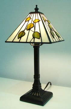 Features: -44 glass cuts. -Hand crafted stained glass. -Requires B10 1x25W bulb (not included). -Vintage bronze finish base. -Tiffany collection. Dimensions: Overall Product Weight: -3 lbs. --T