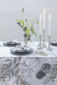 Grey Christmas Tablecloth Karelia | Pentik | The frosty feeling of Karelia has been captured on plywood with watercolours. This earthy pattern is decorated with cones, twigs and delicate snowberries. Karelia collection is designed by Liina Harju.