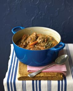 """Wine-Braised Chicken Better known as coq au vin, this rustic French chicken stew gets its richness from bacon and red wine. Serve with crusty bread or buttered noodles. See the """"Wine-Braised Chicken"""" in our One-Pot Meals gallery Chicken Legs And Thighs Recipe, Chicken Thighs, Chicken Recipes Martha Stewart, One Pot Chicken, Chicken Bacon, Chicken Wine, Chicken Stuffing, Chicken Soups, Turkey Bacon"""