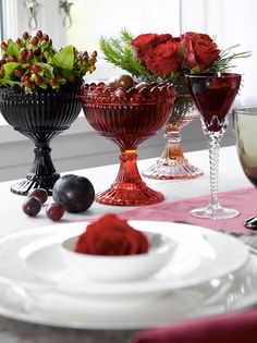 Red and green glass goblets filled with decorations.