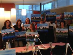 "Here are a few more photographs from ""Let's Paint the Town"" -- which was reported to be a lot of fun. There was a beautiful view of the arch through the window, and the painting was to be of the St. Louis skyline -- so there was a real life view of what was being painted. Joe Buck's Downtown was also great - very accommodating to our group and the food was excellent."