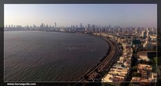 Marine Drive is a skilfully laid-out boulevard, stretching along the coastline of Arabian Sea in South Mumbai. Built in an inverted C shape, this 3 km long concrete road connects the Nariman Point to Malabar Hills. Officially, it is named as Netaji Subhash Chandra Bose Road. It is also known by sobriquets like 'Queen's Necklace' as it appears to be a string of pearls, when viewed from a height during night.