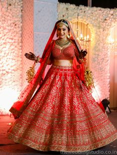 Looking for Red bridal lehenga with choli cut blouse? Browse of latest bridal photos, lehenga & jewelry designs, decor ideas, etc. on WedMeGood Gallery.