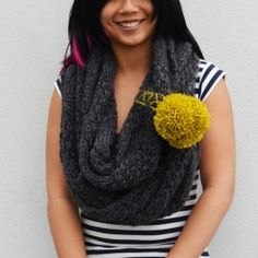 Re-vamp an existing scarf by turning it into a cowl and adding pom poms! - Tutorial in included