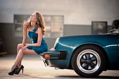 Every gal should match her wardrobe to her Porsche. Extra points if her dress is made of microfiber to buff the bumper while she sits there.
