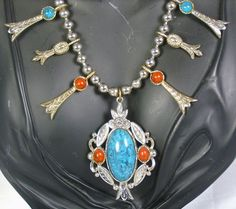30% off Sale until 11/21/15 A beautiful #vintage faux #turquoise and #coral #necklace by Art.  This piece is amazing having a Native American design made up of #silver tone metal beads that compose the nec... #diamonds #gold #rings #art #judysgems2 #teamlove #1960s #floral #long #gift