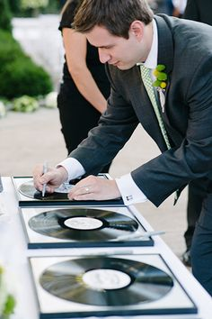 Gather records of your favorite songs for your guests to sign.