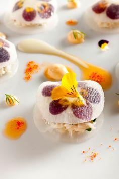crab salad with pickled daikon radish and viola flowers