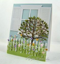 Small Madison Windows, shutters, window box, plus a lots of other Poppystamps dies.     It's created by Kittie Caracciolo, who always does amazing work.