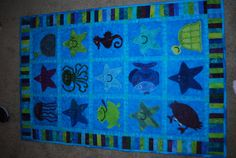 Under the sea quilt with applique sea creatures by andreastough, $200.00