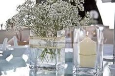 baby's breath 'arrangements' but smaller...our vases are more squat. and  no big candle.