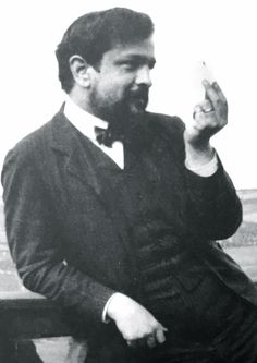 Claude Debussy looking at a cigarette. What Is Classical Music, Classical Music Composers, Portrait Art, Portrait Photography, Portraits, Claude Debussy, Vintage Gentleman, Celebrity Skin, Great Bands
