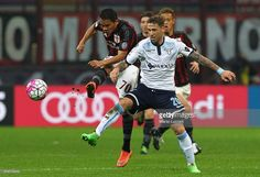 Carlos Bacca of AC Milan competes for the ball with Lucas Biglia of SS Lazio during the Serie A match between AC Milan and SS Lazio at Stadio Giuseppe Meazza on March 20, 2016 in Milan, Italy.