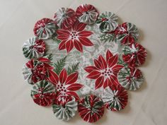 Poinsettia Christmas Yo Yo Mat candles plants vases by SursyShop, $8.00