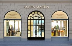 The Aston Martin store in Munich, Germany_ Visual Merchandiser, styling and still life designs Retail Facade, Shop Facade, Facade Design, Exterior Design, Jewelry Store Design, Casa Retro, Luxury Store, Shop Fronts, Life Design