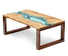 """river coffee table Tables: Coffee Table by Greg Klassen Furniture Maker, available in glass, wood: A vibrant """"river"""" of blue glass intersects two quilted western maple slabs to create a stunning coffee table. Available in custom sizes and woods. Inexpensive Furniture, Cheap Furniture, Wooden Furniture, Furniture Design, Furniture Stores, Japan Design, Table Legs, A Table, Wood Tables"""