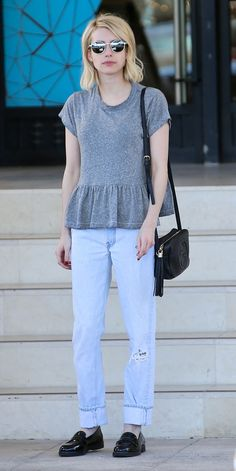 Emma Roberts struck the right balance between feminine and masculine with a sweet peplum tee and sleek patent black loafers.
