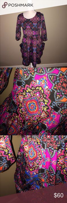"""Band of Gypsies dress Med Boho pattern made of 100% polyester. 23.5"""" arm pit to dress hem See more brands Michael Kors, Lululemon, Gap, Chicos, Lucky, Free People, Urban Outfitters, Coach, Patagonia, boutique, Victoria's Secret, Buckle, Miss Me, Chanel, Burberry, Fossil, Tom's, Pink, & more!! 20% off bundle discounts ! Band of Gypsies Dresses"""