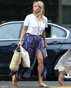 Thighly impressive: She flashed her legs thanks to a daring split in her maxi skirt...