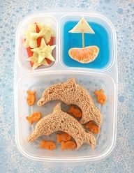Ocean Lunch: Dolphin Sandwiches, Goldfish Crackers, Cucumber Starfish, Blue Jello Water with an Orange Slice Sailboat