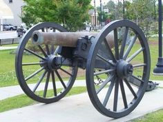 Two historic Civil War cannons, commonly known as 12-pound Napoleons guard the town square. These guns have a bore of 4.62 inches in diameter. 12-pdr Model 1857 Field Gun in Town Square Photo,