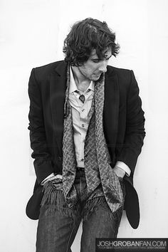 """Josh Groban (played Anatoly Sergeievsky in """"Chess"""") is very good at wearing suit jackets and scarves. Longish hair adds a Bohemian vibe, appropriate for such a songbird. Hard and soft lines."""