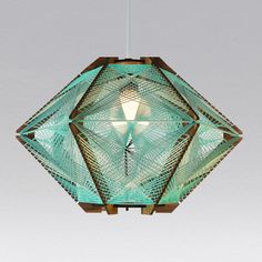 Andromeda Star pendant lamp  in the Sea Foam color way. Sculptural mid-century modern inspired lighting