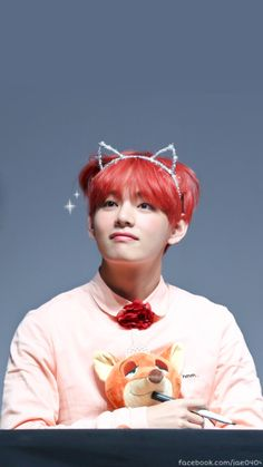 How more cute can he get??? That kitty crown is doing wonders