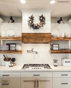 Haus Shiplap hood, whites and woods make for a beautiful farmhouse kitchen. For more farmhouse inspo Modern Farmhouse Kitchens, Farmhouse Kitchen Decor, Kitchen Redo, Home Decor Kitchen, New Kitchen, Home Kitchens, Shiplap In Kitchen, Kitchen Ideas, Kitchen Stove