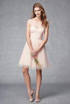 Brides.com: . Style 450292, short tulle dress with directionally pleated bodice, illusion yoke, grosgrain accents, and full sunburst pleated skirt, $298, Monique Lhuillier