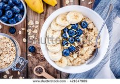 Breakfast: oatmeal with bananas, blueberries, chia seeds and almonds. Top view