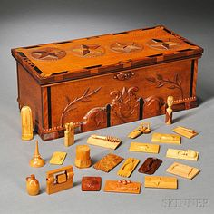 Carved and Inlaid Box with Approximately 197 Carved Wood Samples