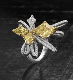 A stunning, vibrant yellow diamond ring from Boodles' Pas de Deux collection, inspired by and in collaboration with The Royal Ballet. This dramatic piece includes both white and yellow diamonds weighing over 4.9cts in total in an eye catching openwork platinum setting.