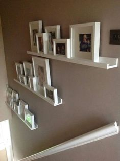 Finished stair gallery using Ikea Ribba rangeSuper idée pour décorer les escaliers ! Finished stair gallery using Ikea Ribba range Picture Shelves, Wall Shelves, Ledge Shelf, Picture Frame, Picture Walls, Stair Gallery, Gallery Walls, Floating Shelves Diy, Floating Stairs