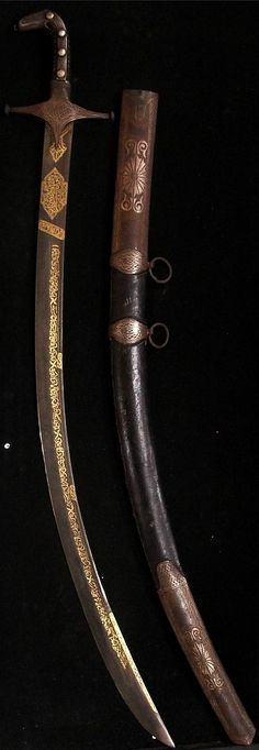 Syrian saif, damascus steel blade, gold koftgari, Islamic stamps and callighraphy, horn handle covered with real silver, pommel and cross guard with silver designs, original scabbard, overall length 36""